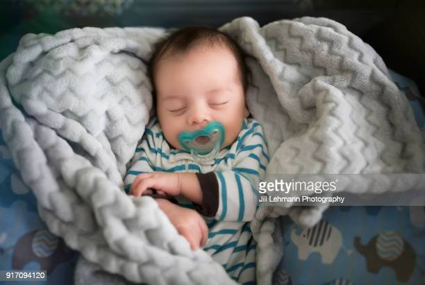 Newborn Baby Sleeps Soundly with Pacifier