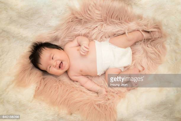 Newborn baby Smiling in bed
