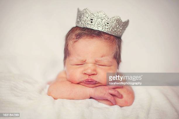 newborn baby wearing crown