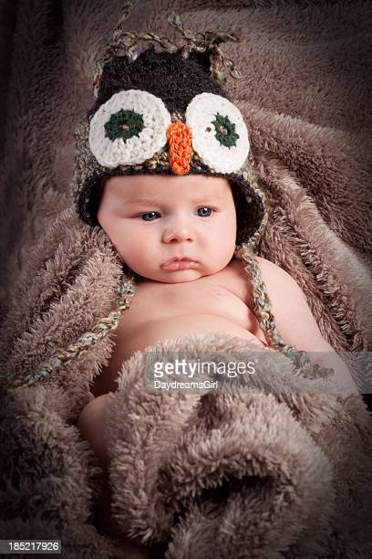 Newborn Baby Wearing Hat and Wrapped in Blanket