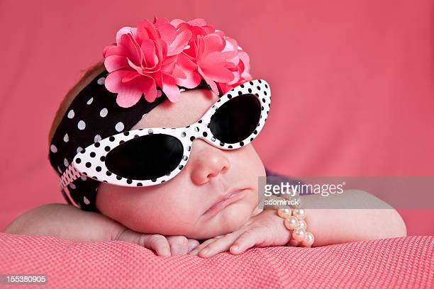 newborn girl in sunglasses - celebrities stock pictures, royalty-free photos & images