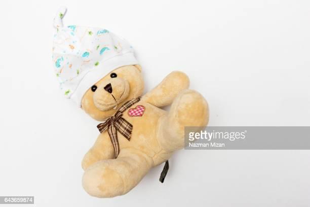 Newborn head gear, put on a bear for sample.