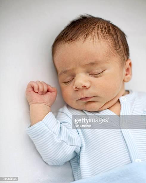 Newborn infant boy sleeping peacefully