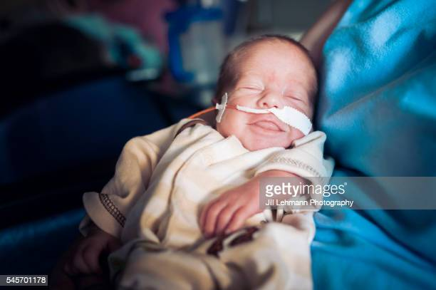 newborn nicu baby smiles - premature stock pictures, royalty-free photos & images