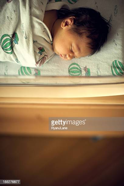 Newborn Sleeping Baby Boy in Hospital Bassinet