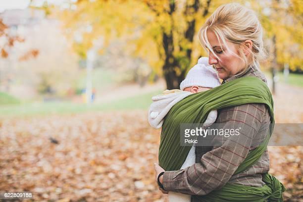 Newborn sleeping in baby carrier