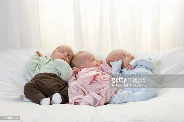 newborn triplets asleep