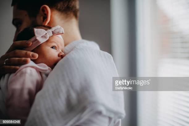 newborn with father - baby girls stock pictures, royalty-free photos & images