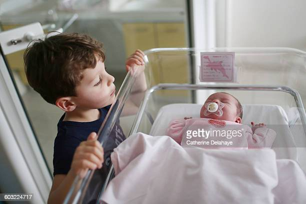 a newborn with her brother at the maternity ward - new life stock pictures, royalty-free photos & images