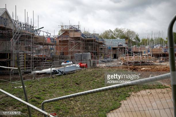 New-build residential homes are pictured during construction at a housing development, stalled due to the COVID-19 pandemic, in Riseley near Reading...