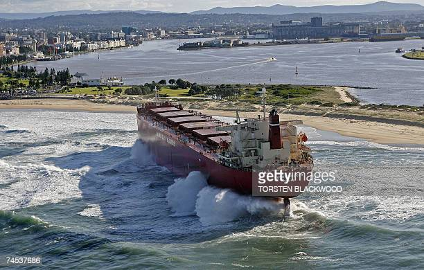 The 30000tonne bulk coal carrier 'Pasha Bulker' is pounded by waves after running aground during severe storms off Nobbys Beach in Newcastle north of...