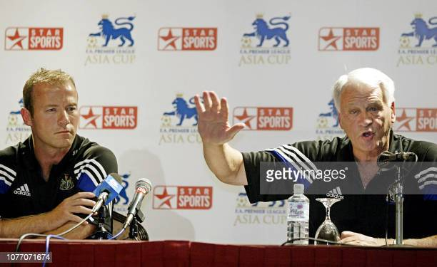 Newcastle captain Alan Shearer looks on while his team manager Sir Bobby Robson speaks during a press conference after arriving in Kuala Lumpur 21...