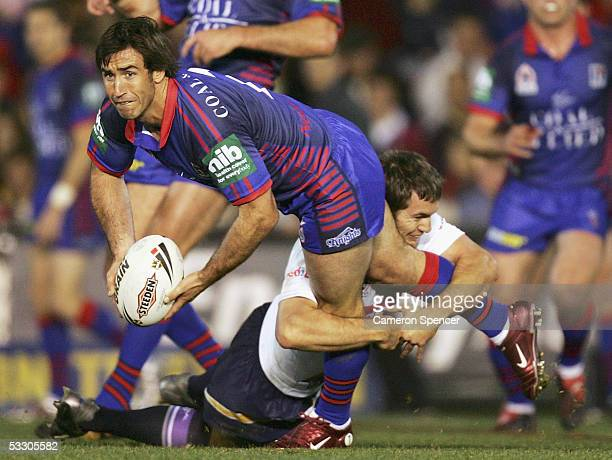 Newcastle Captain Andrew Johns passes the ball during the Round 21 NRL match between the Newcastle Knights and the Melbourne Storm at Energy...
