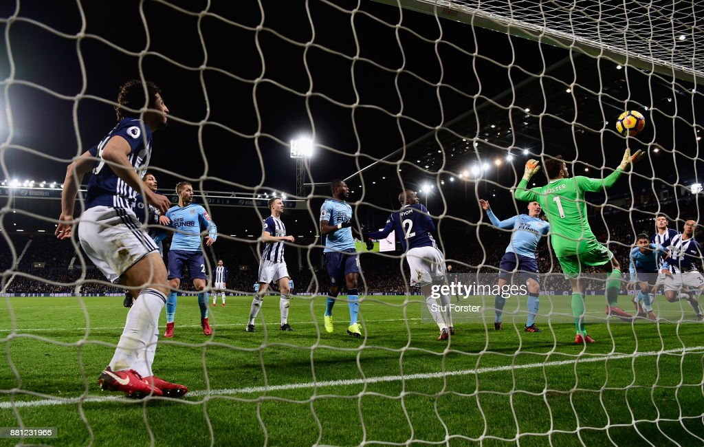 Newcastle captain Ciaran Clark (left of goalkeeper) heads in Newcastle's first goal during the Premier League match between West Bromwich Albion and Newcastle United at The Hawthorns on November 28, 2017 in West Bromwich, England.