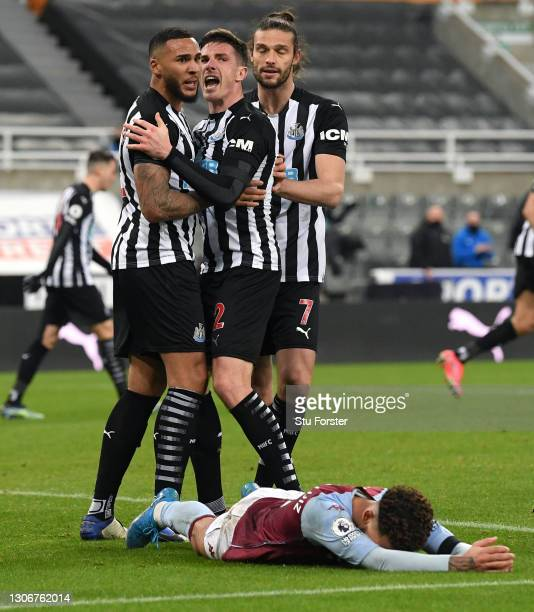 Newcastle captain Jamaal Lascelles is congratulated by Ciaran Clark after scoring the equalising goal during the Premier League match between...