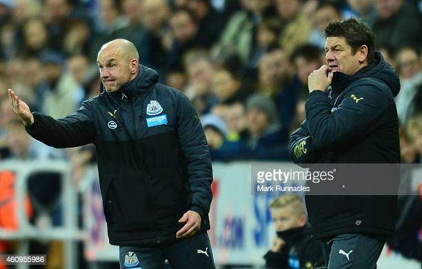 Newcastle caretaker manager John Carver looks on as coach Steve Stone gives instructions during the Barclays Premier League match between Newcastle...