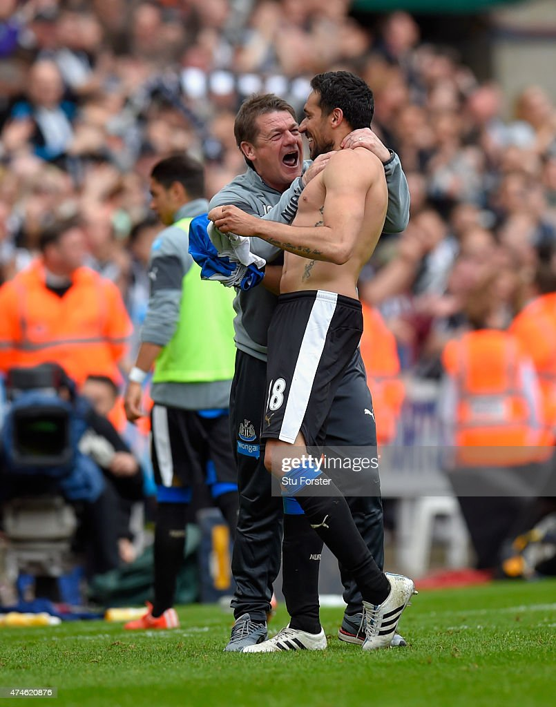 Newcastle coach John Carver (l) congratulates Jonas Gutierrez after the second goal during the Barclays Premier League match between Newcastle United and West Ham United at St James' Park on May 24, 2015 in Newcastle upon Tyne, England.