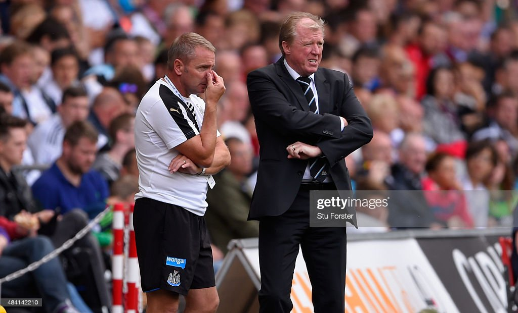 Newcastle coach Steve McClaren and assistant Paul Simpson (l) look on during the Barclays Premier League match between Swansea City and Newcastle United at the Liberty stadium on August 15, 2015 in Swansea, United Kingdom.