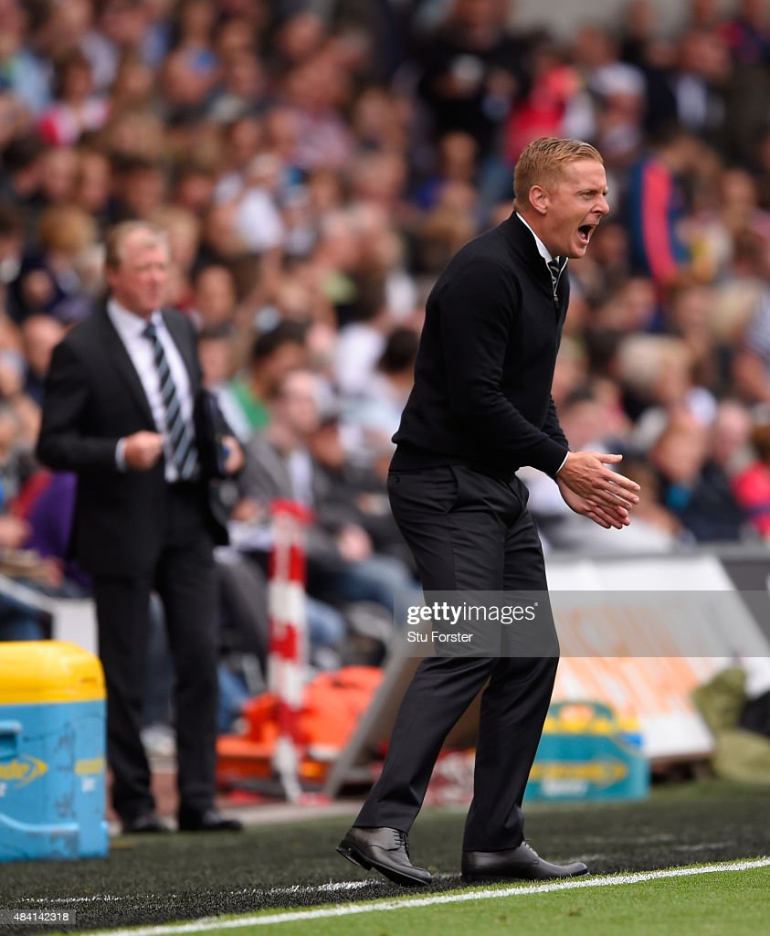 Newcastle coach Steve McClaren looks on as Swansea manager Garry Monk reacts during the Barclays Premier League match between Swansea City and Newcastle United at the Liberty stadium on August 15, 2015 in Swansea, United Kingdom.