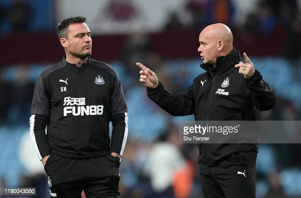 Newcastle coaches Steve Harper and Steve Agnew chat during the warm up before the Premier League match between Aston Villa and Newcastle United at...