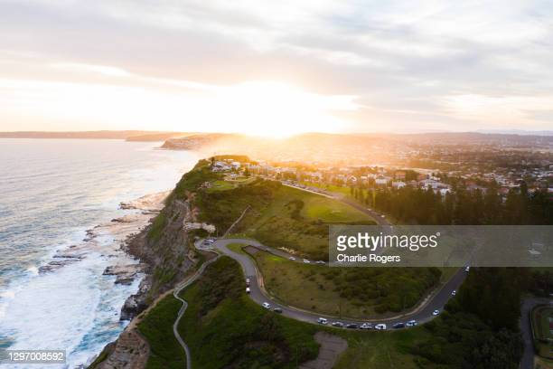 newcastle coast at sunset - newcastle new south wales stock pictures, royalty-free photos & images