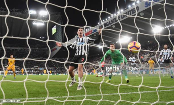 Newcastle defender Ciaran Clark and goalkeeper Martin Dubravka look on as the winning goal scored by Matt Doherty goes into the net during the...