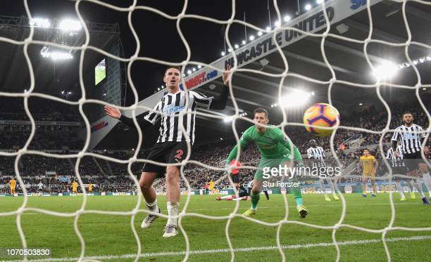 Newcastle defender Ciaran Clark and goalkeeper Martin Dubravka look on as the winning Wolves goal scored by Matt Doherty goes into the net during the...