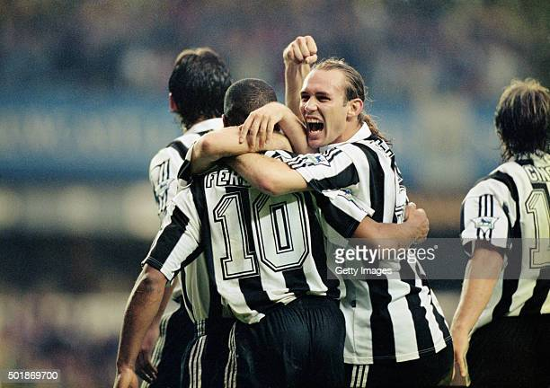 Newcastle defender Darren Peacock celebrates with goalscorer Les Ferdinand after the striker had scored the third Newcastle goal during the 50...