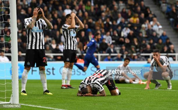 Newcastle defender DeAndre Yedlin and team mates react after diverting the ball into his goal for the winning Chelsea goal during the Premier League...