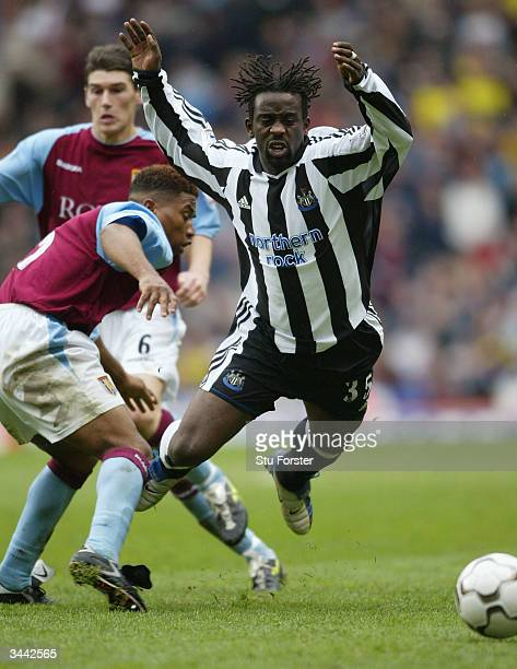 Newcastle defender Olivier Bernard is felled by Ulises De La Cruz of Villa during the FA Barclaycard Premiership match between Aston Villa and...