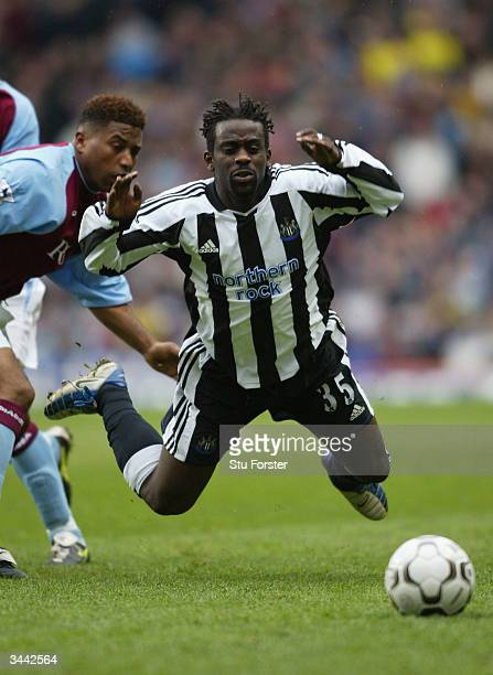 Newcastle defender Olivier Bernard is felled by Ulises De La Cruzof Villa during the FA Barclaycard Premiership match between Aston Villa and...
