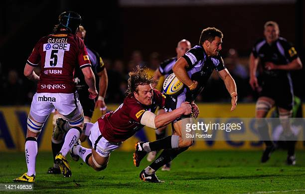 Newcastle Falcons flyhalf Jimmy Gopperth is tackled just short of the line by Andy Powell of Sale during the Aviva Premiership match between...