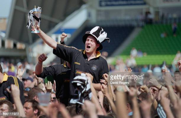 Newcastle Falcons player Doddie Weir celebrates with the trophy after the Falcons had beaten Harlequins to claim the 1997/98 Allied Dunbar...