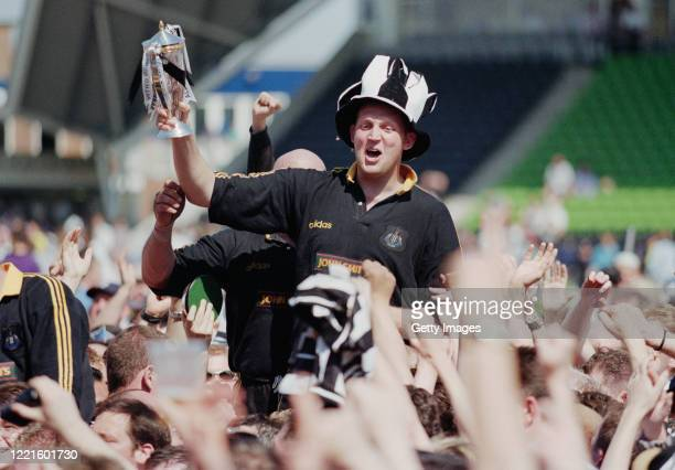 Newcastle Falcons player Doddie Weir is chaired off with the trophy after the Falcons had beaten Harlequins to claim the 1997/98 Allied Dunbar...