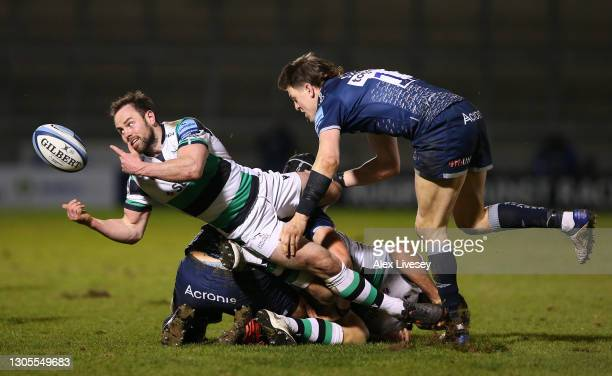 Newcastle Falcons replacement scrum half Micky Young escapes the clutches of Sam James during the Gallagher Premiership Rugby match between Sale and...