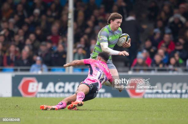 Newcastle Falcons' Simon Hammersley evades the tackle of Exeter Cheifs' Tom O'Flaherty during the Anglo Welsh Cup Semi Final match between Exeter...