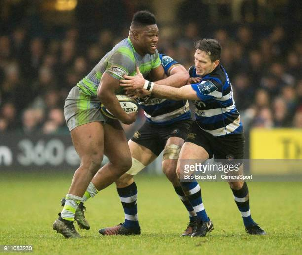 BATH ENGLAND JANUARY Newcastle Falcons' Simon Uzokwe is tackled by Bath Rugby's Darren Allinson during the Anglo Welsh Cup Round Three match between...