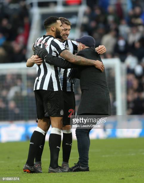 Newcastle fan celebrates victory with Florian Lejeune and Jamaal Lascelles during the Premier League match between Newcastle United and Manchester...