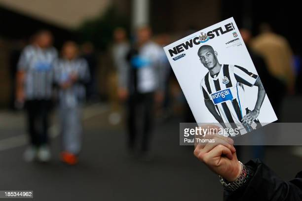 Newcastle fan holds up a match day programme before the Barclays Premier League match between Newcastle United and Liverpool at St James' Park on...