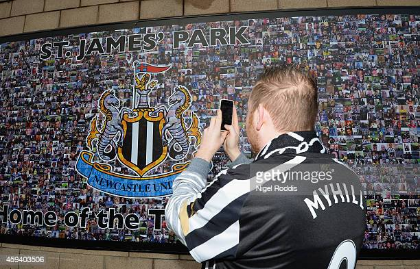 Newcastle fan takes a photograph ahead of the Barclays Premier League match between Newcastle United and Queens Park Rangers at St James' Park on...