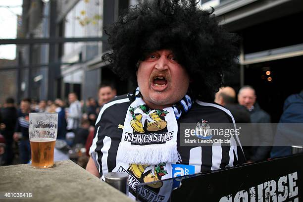 Newcastle fan wearing an afro wig cheers his side on outside the pub before the Barclays Premier League match between Newcastle United and Sunderland...