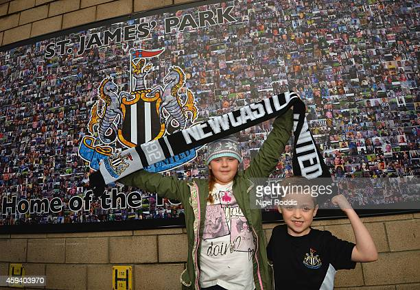 Newcastle fans Alex Dad and Louis Grey pose ahead of the Barclays Premier League match between Newcastle United and Queens Park Rangers at St James'...