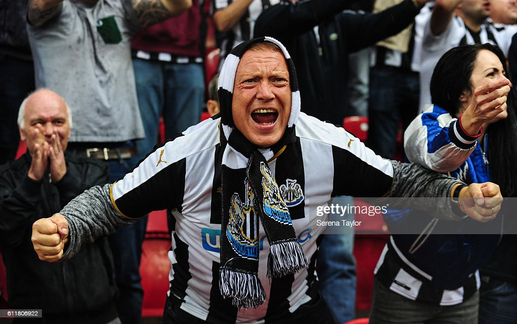Newcastle fans celebrate during the Sky Bet Championship match between Rotherham United and Newcastle United at The New York Stadium on October 1, 2016 in Rotherham, England.