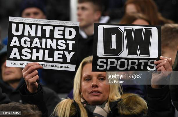 Newcastle fans holds up 'United Against Ashley' cards during the Premier League match between Newcastle United and Manchester City at St James Park...
