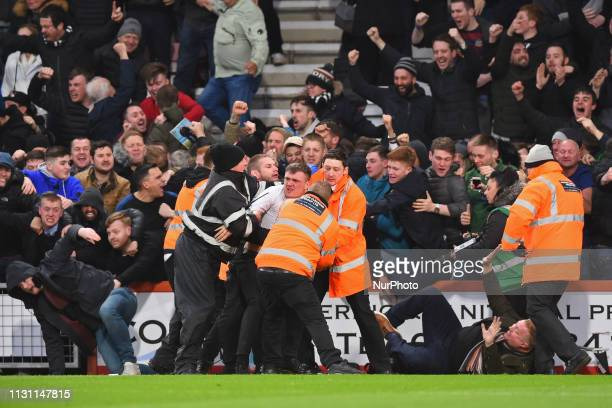 Newcastle fans invade the pitch after a last minute goal to equalise during the Premier League match between Bournemouth and Newcastle United at the...