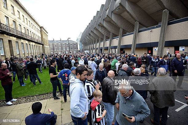 Newcastle fans mill around outside the ground as kickoff is delayed due to a big screen coming loose prior to kickoff during the Barclays Premier...