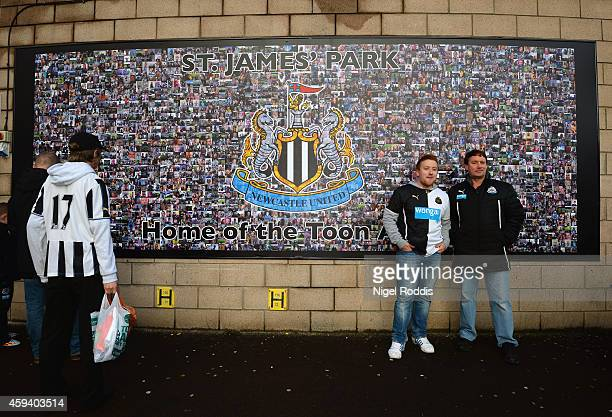 Newcastle fans pose in front of the mural ahead of the Barclays Premier League match between Newcastle United and Queens Park Rangers at St James'...