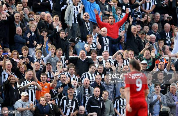 Newcastle fans react as Andy Carroll of Liverpool walks off after being substituted during the Barclays Premier League match between Newcastle United...