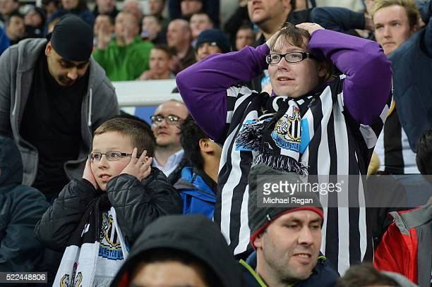 Newcastle fans react during the Barclays Premier League match between Newcastle United and Manchester City at St James' Park on April 19 2016 in...