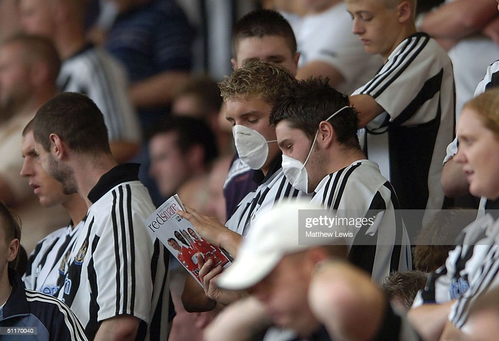 newcastle-fans-wear-masks-during-the-bar